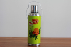 Product image for:Thermoskanne 1.2 L, hellgrün mit Mohn (1359)